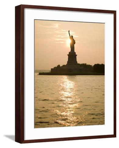 Sun Setting Behind the Statue of Liberty on a Summer Evening-John Nordell-Framed Art Print