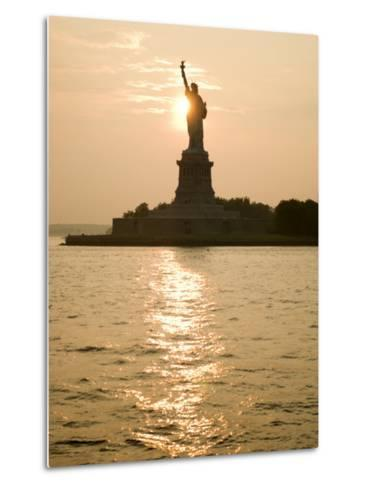 Sun Setting Behind the Statue of Liberty on a Summer Evening-John Nordell-Metal Print
