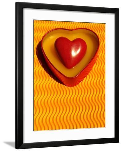 A Love Stone Heart with Yellow Background-Abdul Kadir Audah-Framed Art Print