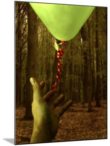 Hand Reaching for Balloon in Forest-Abdul Kadir Audah-Mounted Photographic Print
