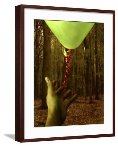 Hand Reaching for Balloon in Forest-Abdul Kadir Audah-Framed Art Print