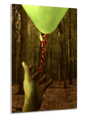 Hand Reaching for Balloon in Forest-Abdul Kadir Audah-Metal Print