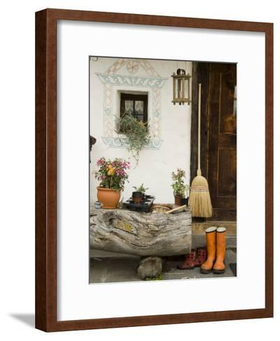Boots, a Broom and Flowers Outside a Chalet-Annie Griffiths Belt-Framed Art Print