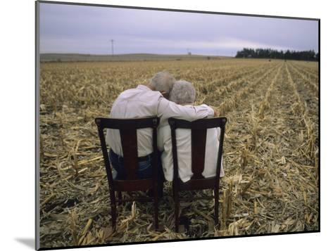 Elderly Couple Embrace in a Cornfield-Joel Sartore-Mounted Photographic Print