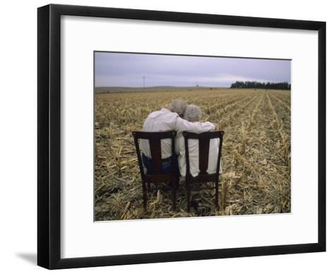 Elderly Couple Embrace in a Cornfield-Joel Sartore-Framed Art Print