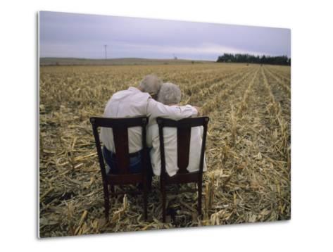 Elderly Couple Embrace in a Cornfield-Joel Sartore-Metal Print