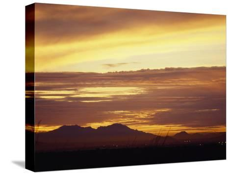 Sun Sets Behind Mountains in Arizona-xPacifica-Stretched Canvas Print