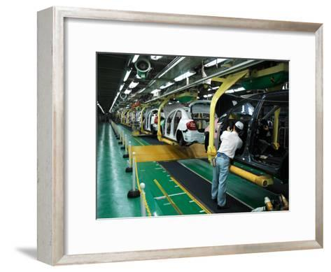Man Assembles a Prius Car on an Assembly Line at the Toyota Plant-xPacifica-Framed Art Print