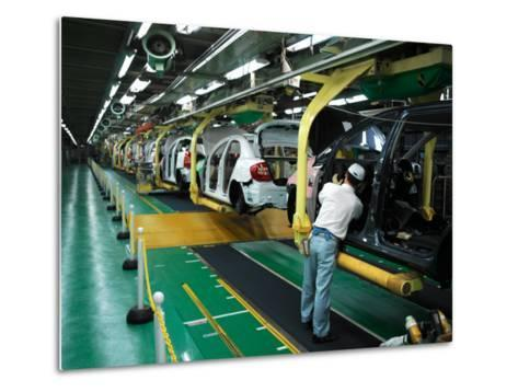 Man Assembles a Prius Car on an Assembly Line at the Toyota Plant-xPacifica-Metal Print
