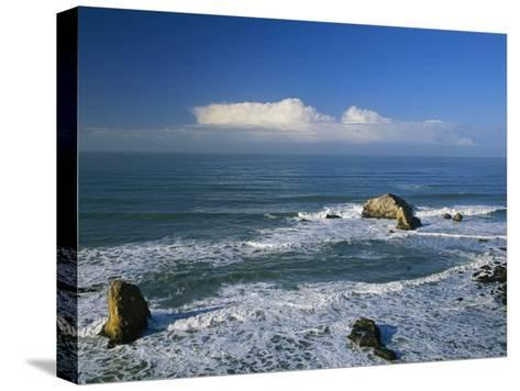 Clouds over the Pacific Ocean and Surf Spilling onto Shell Beach-Marc Moritsch-Stretched Canvas Print