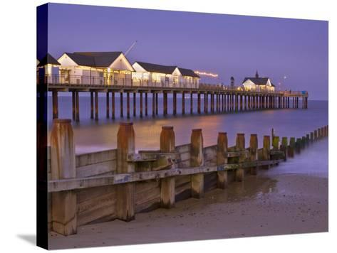 Southwold Pier and Wooden Groyne at Sunset, Southwold, Suffolk, England, United Kingdom, Europe-Neale Clark-Stretched Canvas Print