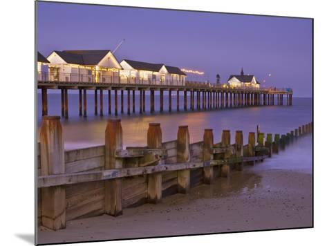 Southwold Pier and Wooden Groyne at Sunset, Southwold, Suffolk, England, United Kingdom, Europe-Neale Clark-Mounted Photographic Print