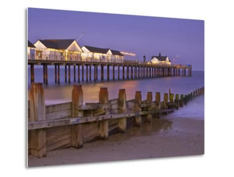 Southwold Pier and Wooden Groyne at Sunset, Southwold, Suffolk, England, United Kingdom, Europe-Neale Clark-Metal Print