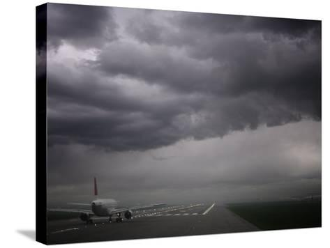 Plane Ready for Take Off and Stormy Skies, Heathrow Airport, London, England, United Kingdom--Stretched Canvas Print