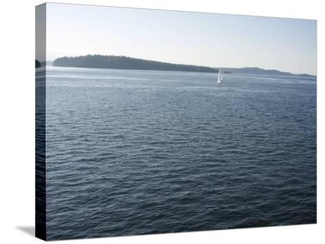 Sailboat on the Puget Sound Passes Blake Island, Washington State, United States of America-Aaron McCoy-Stretched Canvas Print