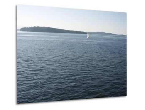 Sailboat on the Puget Sound Passes Blake Island, Washington State, United States of America-Aaron McCoy-Metal Print