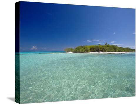 Tropical Island and Lagoon, Baa Atoll, Maldives, Indian Ocean-Sakis Papadopoulos-Stretched Canvas Print