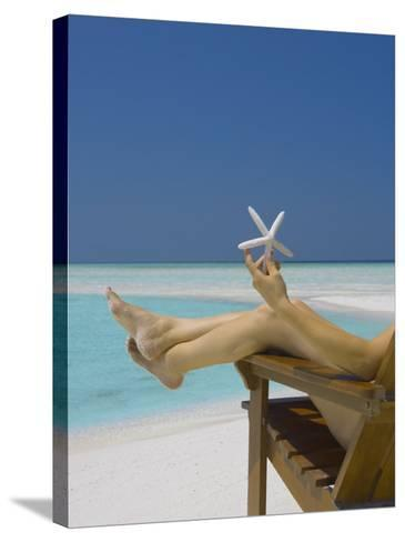 Woman Holding Seastar on the Beach, Maldives, Indian Ocean, Asia-Sakis Papadopoulos-Stretched Canvas Print