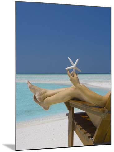 Woman Holding Seastar on the Beach, Maldives, Indian Ocean, Asia-Sakis Papadopoulos-Mounted Photographic Print