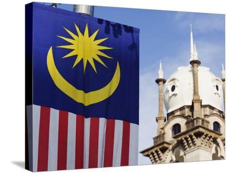 Malaysian Flag and Old Kl Railway Station, Kuala Lumpur, Malaysia, Southeast Asia, Asia-Christian Kober-Stretched Canvas Print