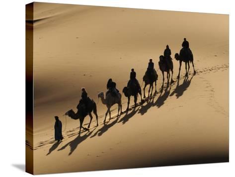 Bedouin Caravan Riding Through the Sahara Desert, Near Merzouga, Morocco, North Africa, Africa-Michael Runkel-Stretched Canvas Print