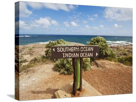Sign Marking the Southern and Indian Oceans at Cape Leeuwin, Western Australia-Robert Francis-Stretched Canvas Print