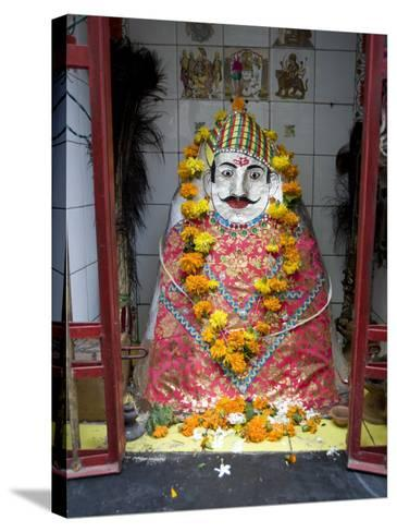 Hindu Street Shrine, Decorated with Marigold Mala (Garlands) for Diwali Festival, Udaipur, India-Annie Owen-Stretched Canvas Print