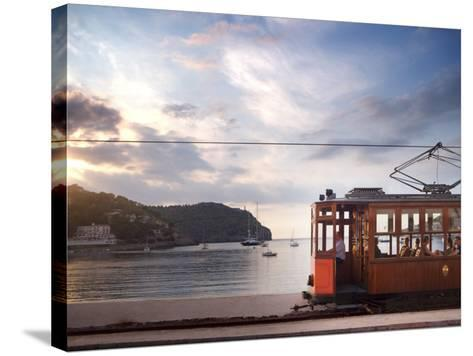 Tram at Sunset Set Against Yachts in Bay, Soller, Mallorca, Balearic Islands, Spain, Mediterranean--Stretched Canvas Print
