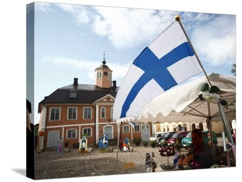 Finnish Flag and Medieval Town Hall, Old Town Square, Porvoo, Uusimaa, Finland, Scandinavia, Europe--Stretched Canvas Print