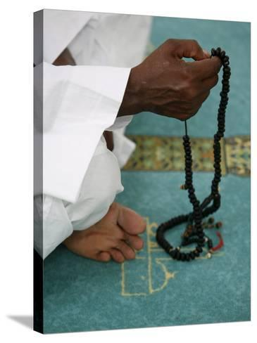 Muslim with Prayer Beads, Lyon, Rhone Alpes, France, Europe-Godong-Stretched Canvas Print