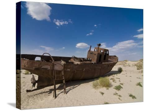 Rusting Boats Lying in the Desert Which Used to Be the Aral Sea, Moynaq, Uzbekistan, Central Asia-Michael Runkel-Stretched Canvas Print
