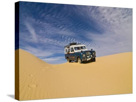 Jeep Driving Through the High Sand Dune of Western Desert, Near Siwa, Egypt, North Africa, Africa-Michael Runkel-Stretched Canvas Print