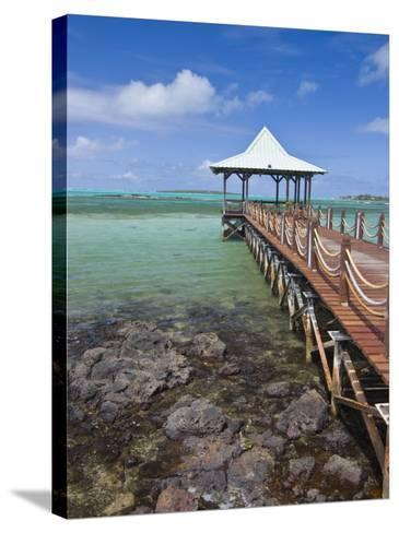 Pier Is Leading into the Blue Sea and Ends in a Small Hut, Mauritius, Indian Ocean, Africa-Michael Runkel-Stretched Canvas Print