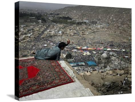 Afghan Youth Sits on a Rooftop During the Celebration of Nowruz--Stretched Canvas Print