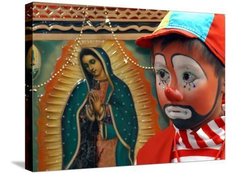 """Young Clown, """"Bolillito,"""" Stands Next to an Image of the Virgin of Guadalupe in Mexico City--Stretched Canvas Print"""