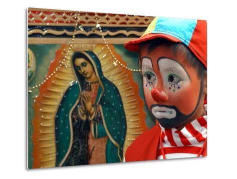 """Young Clown, """"Bolillito,"""" Stands Next to an Image of the Virgin of Guadalupe in Mexico City--Metal Print"""