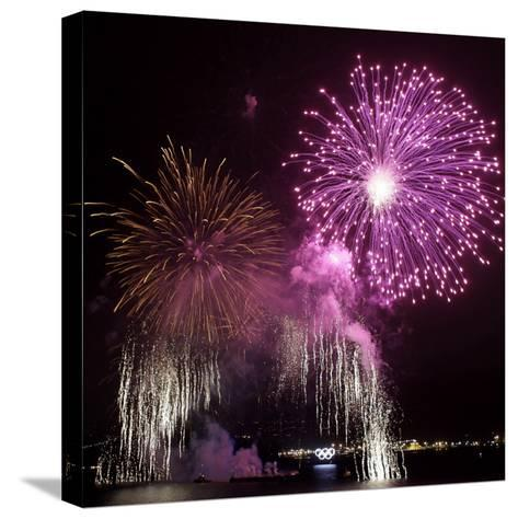Fireworks Explode over the Olympic Rings During the Opening Ceremony of the Vancouver 2010 Olympics--Stretched Canvas Print