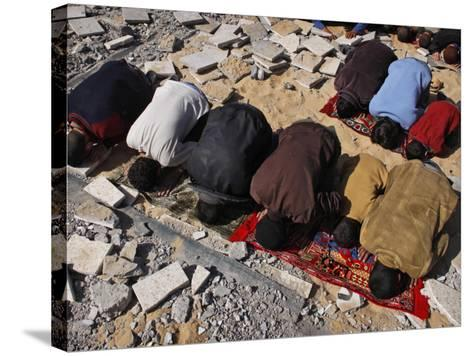 Palestinians Pray in Rubble of Mosque Destroyed in Israeli Military Offensive, Northern Gaza Strip--Stretched Canvas Print