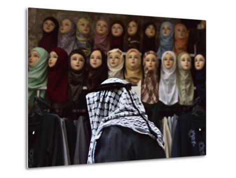 Palestinian Man Passes in Front of a Shop Offering Veils for Sale in Jerusalem's Old City--Metal Print