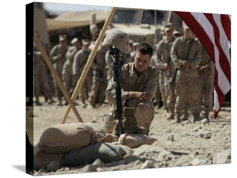 US Marine Pays His Respects to LCpl Joshua Bernard During a Memorial Service at Base in Afghanistan--Stretched Canvas Print