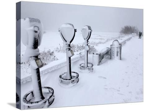 Telescope Viewers are Covered in Snow Overlooking Lighthouse Beach in Chatham, Massachusetts--Stretched Canvas Print