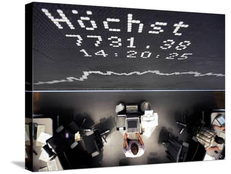 Brokers Under a Curve of German Stock Index Dax at Stock Market in Frankfurt, Central Germany--Stretched Canvas Print