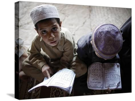 Afghan Refugee Children Read Verses of the Quran During a Daily Class at a Mosque in Pakistan--Stretched Canvas Print