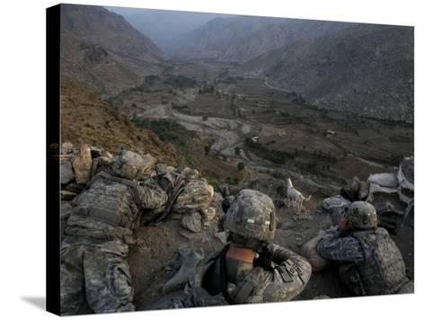 US Soldiers Take an Overwatch Position on a Mountain Top in the Pech Valley, Afghanistan--Stretched Canvas Print