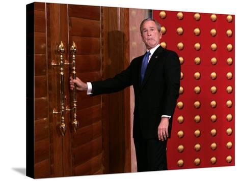 President George W. Bush as He Tries to Open a Locked Door Leaving a Press Conference in Beijing--Stretched Canvas Print