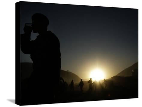 Soldier of the Afghan National Army Drinks Tea at Sunset in Kabul, Afghanistan--Stretched Canvas Print