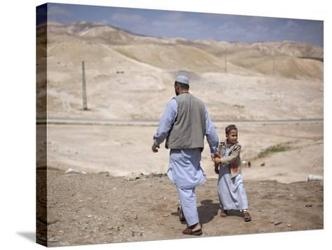 Palestinian Father and Son Walk in Desert During Celebrations Marking the Annual Day of Nebi Musa--Stretched Canvas Print
