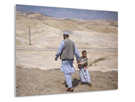 Palestinian Father and Son Walk in Desert During Celebrations Marking the Annual Day of Nebi Musa--Metal Print