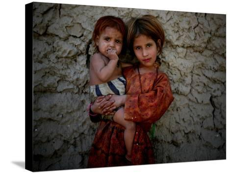 Afghan Girl Holds Her Younger Sister in Nangarhar Province, East of Kabul, Afghanistan--Stretched Canvas Print