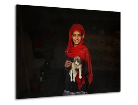 Girl Holds a Puppy as the Sun Sets over Kabul's Impoverished Teppe Maranjan Neighborhood--Metal Print